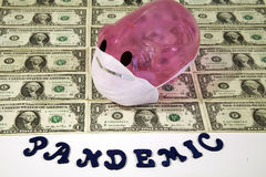Swine Flu Pandemic. Pink pig with surgical mask representing swine flu on a sheet of US dollars and the word Pandemic Stock Photos
