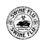 Swine flu rubber stamp. Black grunge rubber stamp with pig shape and the text swine flu written inside the stamp Stock Image