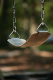 Swing. Empty Swing on a Playground royalty free stock photo