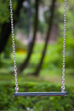 Swing. On a green garden background Stock Photography