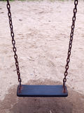 Swing. In playground hanging over sand surface Royalty Free Stock Photography