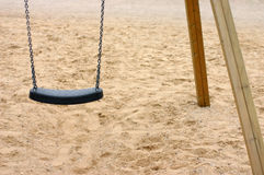 Swing. Fragment of the chain swing standing on the beach Stock Image