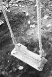 Swing. Old wood swing in a park in autumn Stock Photography