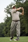 Swing. Male golfer completes swing stock images