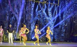 Swing acrobatics of actress Stock Photo