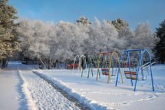 Free Swing At The Playground Covered With Snow In Winter Time. Royalty Free Stock Images - 108272259