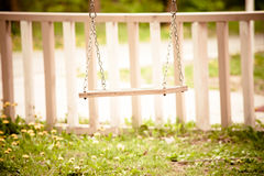 Swing in backyard Royalty Free Stock Photos