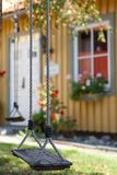 Swing in the backyard in the old part of Vasteras town Stock Images