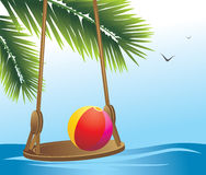 Swing and beach ball among palms stock images