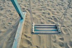 Swing on the beach. Blue  Swing on the beach Stock Photo