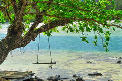 Swing on the beach at Kood Island Thailand. Swing Blue Ocean Clear Water Stock Images