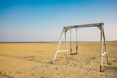 Swing on beach of  Lido di Spina, Italy royalty free stock images