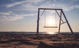 Swing on the beach Stock Image