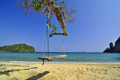Swing ,beach and tree Royalty Free Stock Images