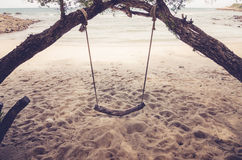 Swing on beach vintage Royalty Free Stock Photos