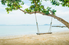 Swing on beautiful tropical sand beach Royalty Free Stock Photo