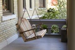 A Swing Bench on a Veranda Royalty Free Stock Photography