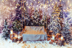 Swing with a blanket on it in a snow-covered park Stock Photos