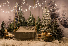 Swing with a blanket on it under the flashlights in a snow-cover Royalty Free Stock Images