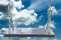 Swing and blue sky in background Stock Image