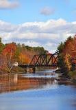 Swing Bridge. A golden autumn shoreline along a lake in fall time Stock Photography
