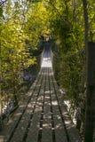 Swing Bridge. A swing bridge over a river taken in New Zealand Stock Image