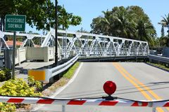 Swing bridge moves out of the way for a boat to get by. 11th Avenue Swing Bridge opens up and swings out of the way to let boats by in downtown Fort Lauderdale Stock Photography