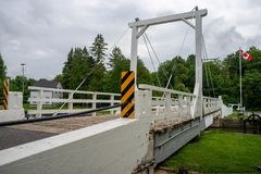 Swing bridge over canal lock royalty free stock photography