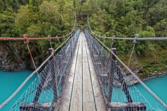 Swing bridge over the Hokitika river, west coast, New Zealand royalty free stock images