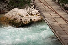 Swing bridge. Over the river Soca in Slovenia Royalty Free Stock Photos