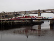 Swing Bridge over the river Tyne. In Newcastle, UK. It gets its name from its ability to rotate 90 degrees to allow tall ships to pass Stock Photo