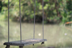 Swing beside canal Stock Photo