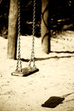 Swing casts shadows Stock Photos