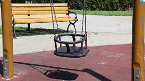 Swing. Chain swing moves and wooden bench in background stock video