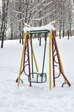Swing for children in the park in winter Royalty Free Stock Image