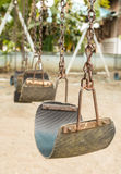 Swing in children playground Stock Photos