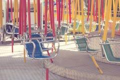Swing on children playground Stock Photos