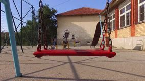 Swing for children in the summer. This is a footage of Swing for children in the summer stock footage