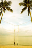 Swing on coconut tree on the beach Royalty Free Stock Photo