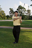 Swing Completed. Man after completing a golf swing royalty free stock images