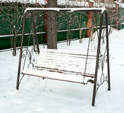 Swing covered in snow Royalty Free Stock Images