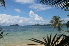 Swing or cradle hang on coconut tree beautiful nuture blue sky and shadow at koh Mak beach Trad Thailand Stock Photo
