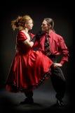Swing dancers. On black background Stock Images