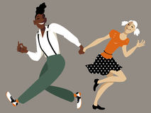 Swing dancing couple Royalty Free Stock Photos