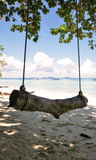 Swing in dark shadows. A swing on the beach Stock Photography