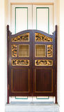 Swing Door of Peranakan Design. A house of peranakan (Straits chinese) architectural style  with the traditionally style swing door before the main door Royalty Free Stock Photos