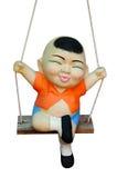 swing för ritt för barnleradocka Arkivbild