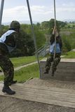 Swing the gap. 2 female UK soldiers on assault course royalty free stock images