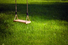 Swing in a garden Stock Images