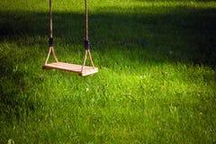 Swing in a garden. A swing in a garden Stock Images